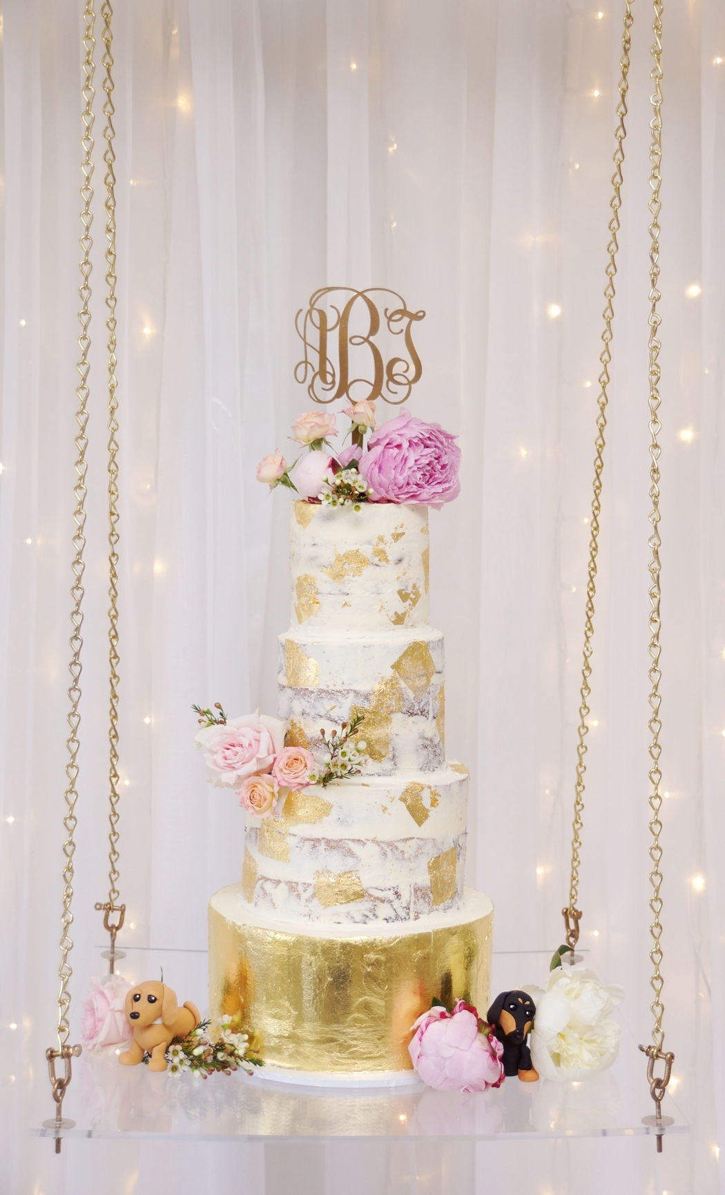 4 Tier buttercream with gold leaf 1