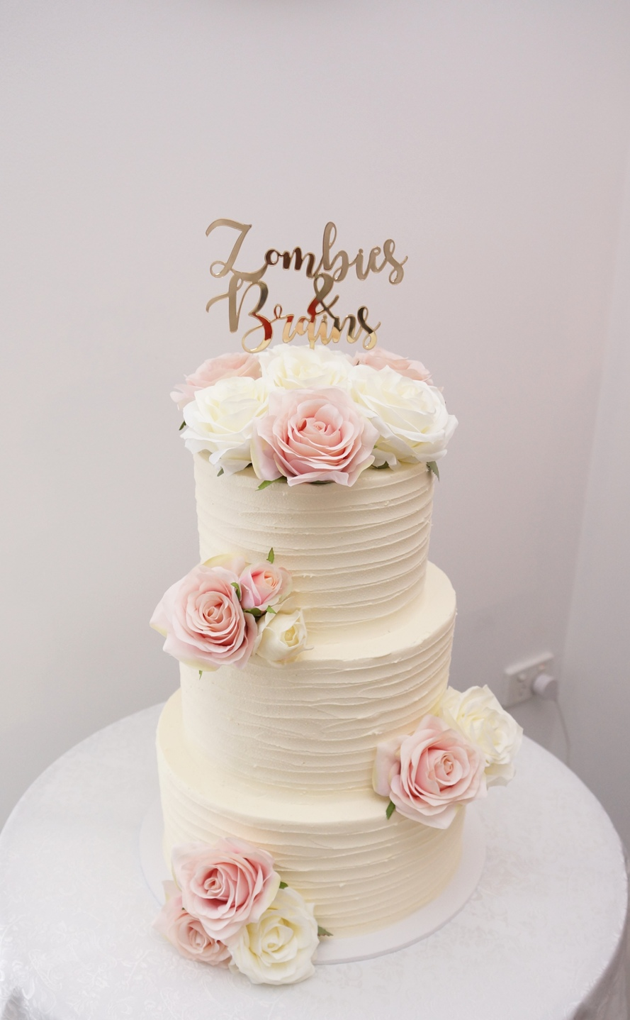 3 Tier Lined buttercream with silk flowe