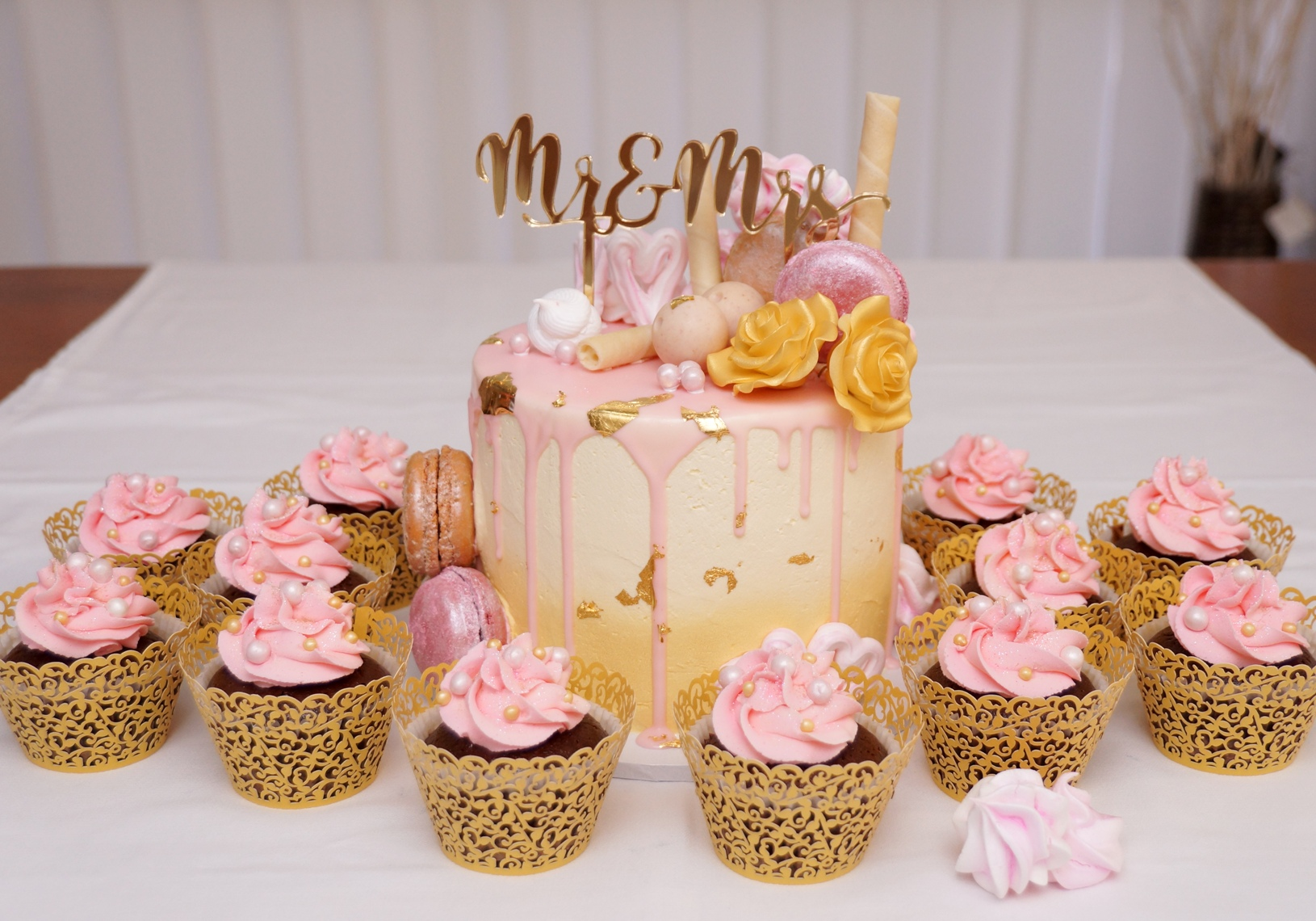 1 Tier pink choc drip with cupcakes 2
