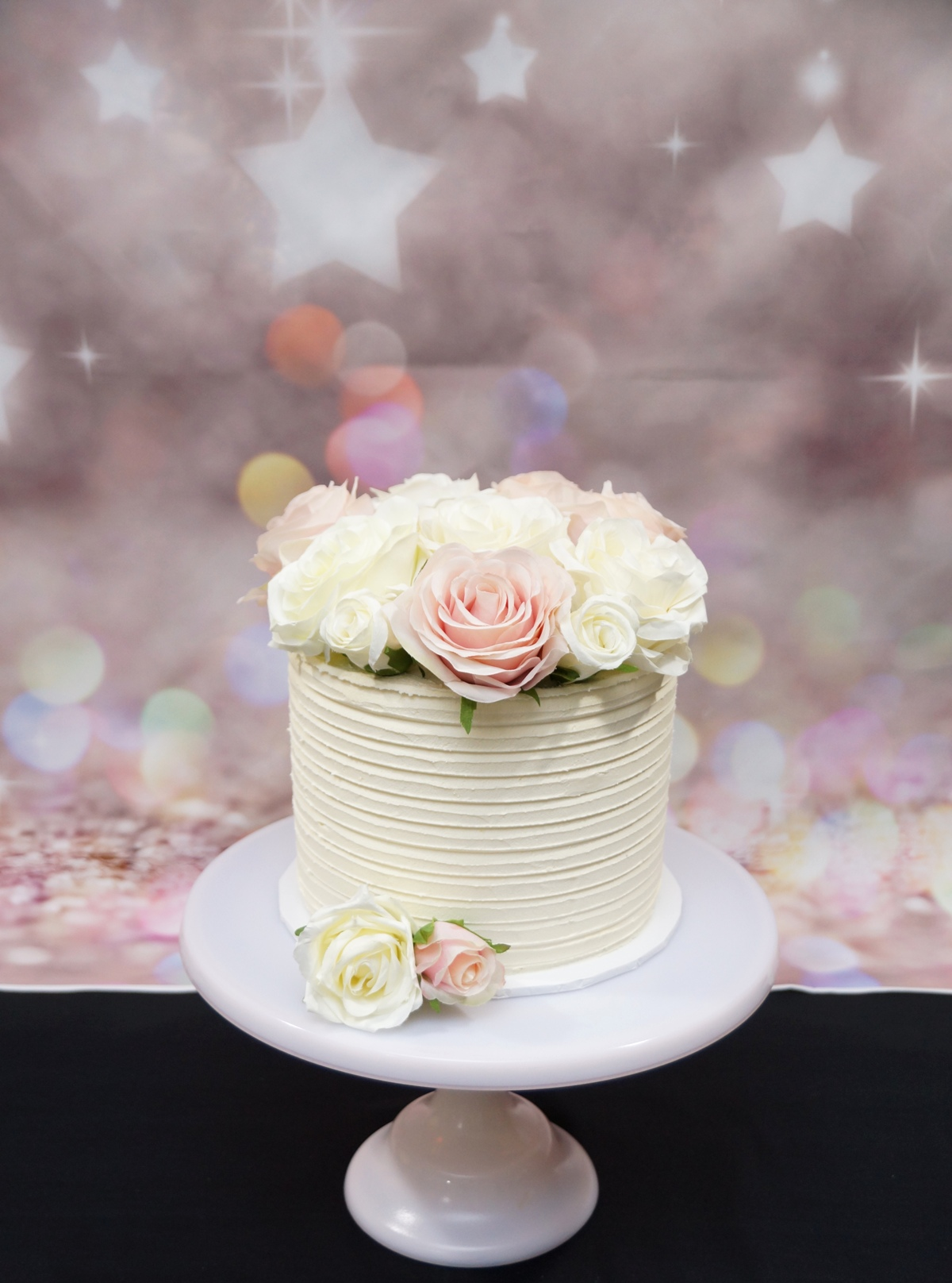1 Tier Lined white buttercream with silk