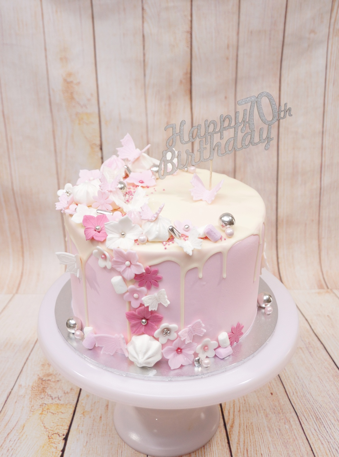 Pink buttercream with white chocolate dr