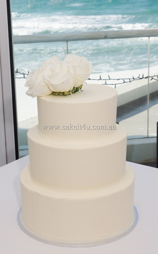 3 Tier smooth buttercream with 4 white roses 1
