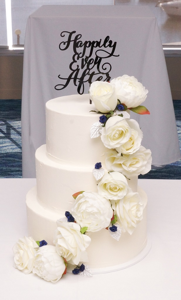 3 tier buttercream with white flowers 1.
