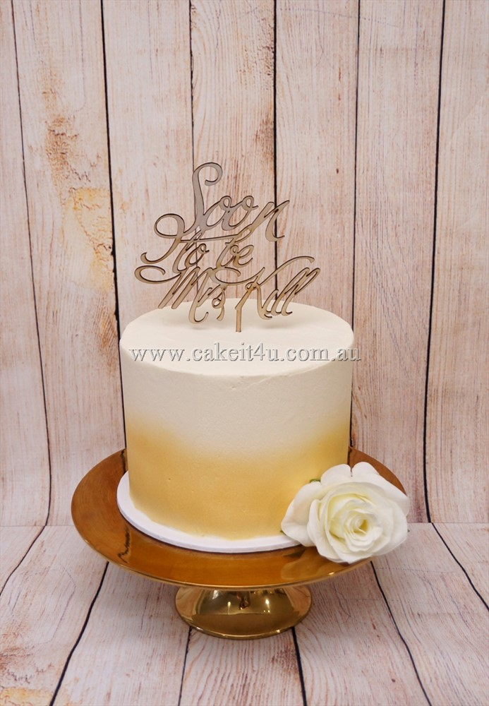 1 tier buttercream with gold airbrush