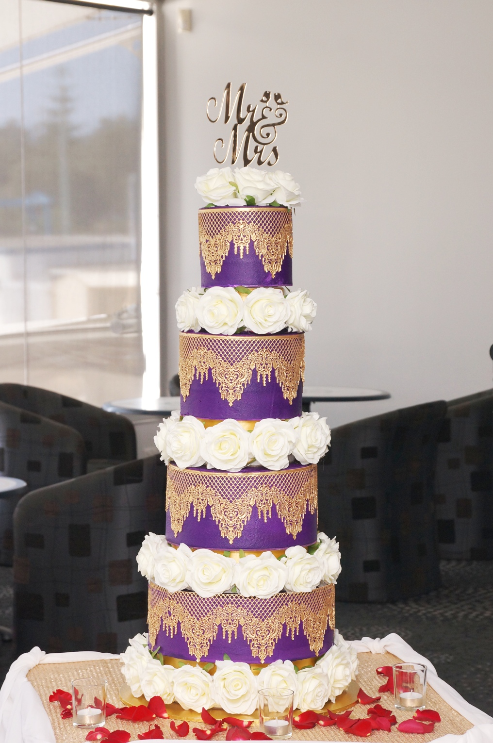 8 Tier Purple and Gold Cake with White s