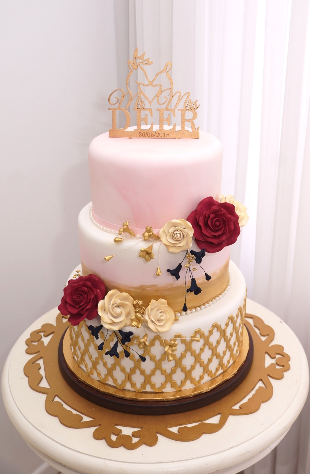 Blush, gold and navy wedding cake 1