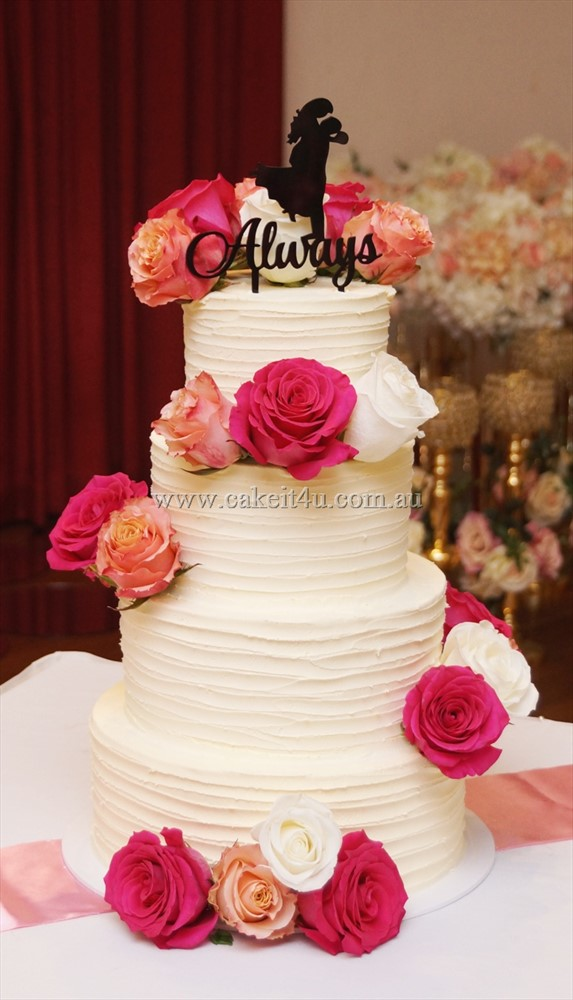 4 Tier textured buttercream with fresh roses