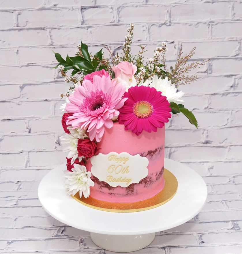 1 Tier bright pink buttercream with fres