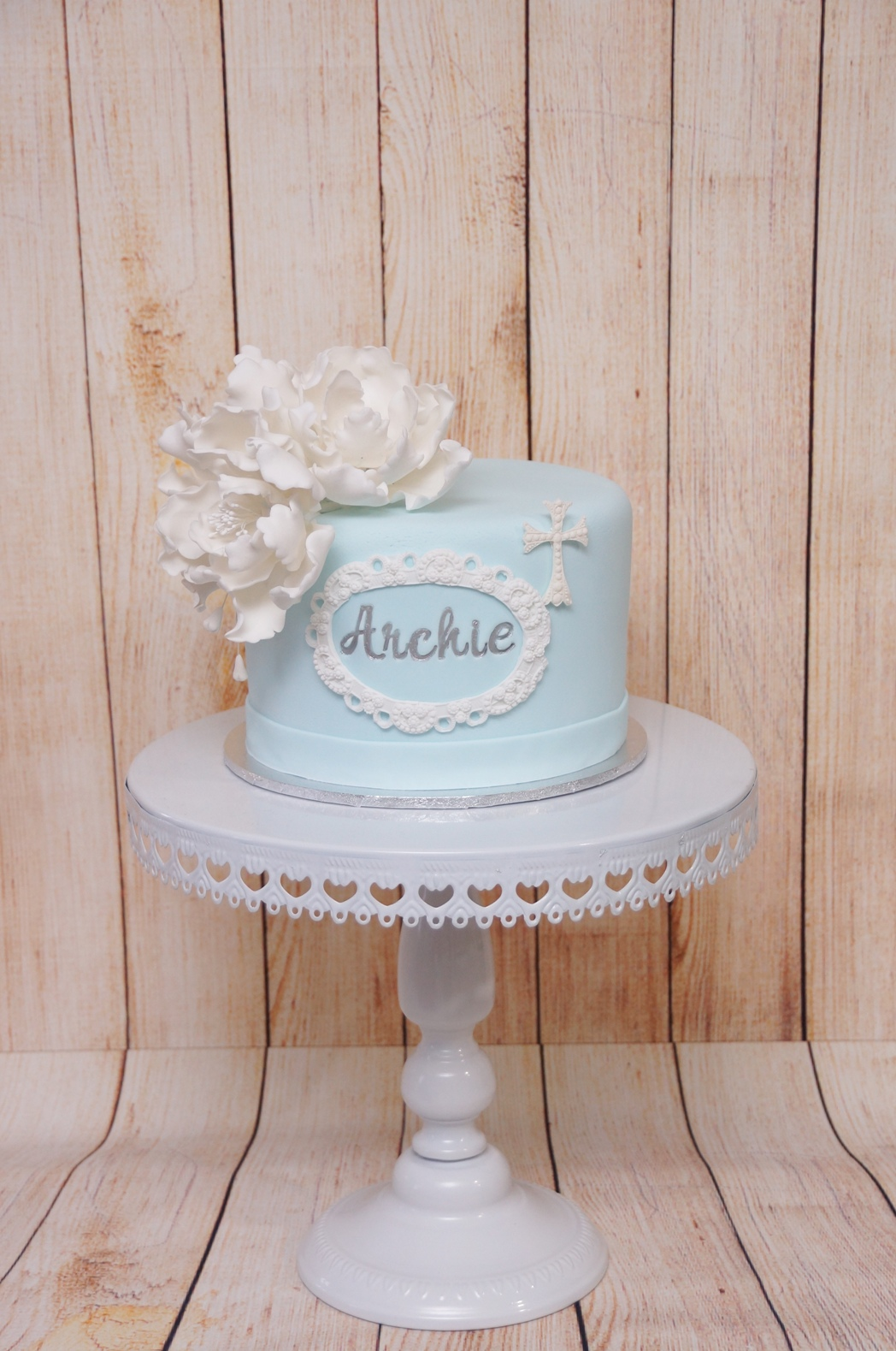 Blue white and silver christening cake w