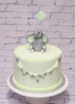 Green and grey Baby shower cake with ele