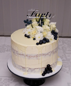 Semi Naked with chocolate drip, fresh berries and flowers