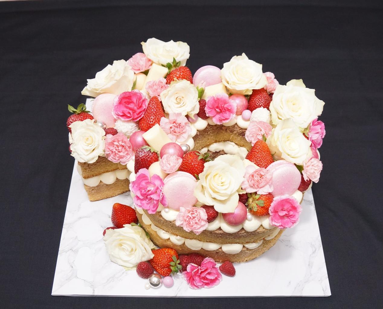 Engagement ring shape cake with fresh fl