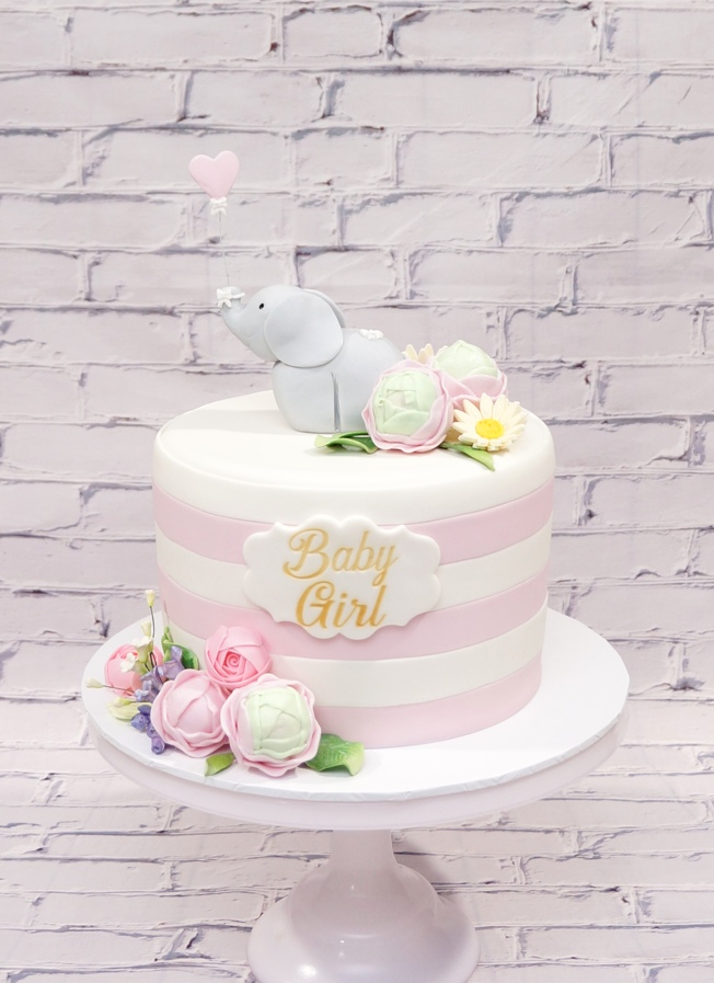 Pink & White stipe baby shower cake with