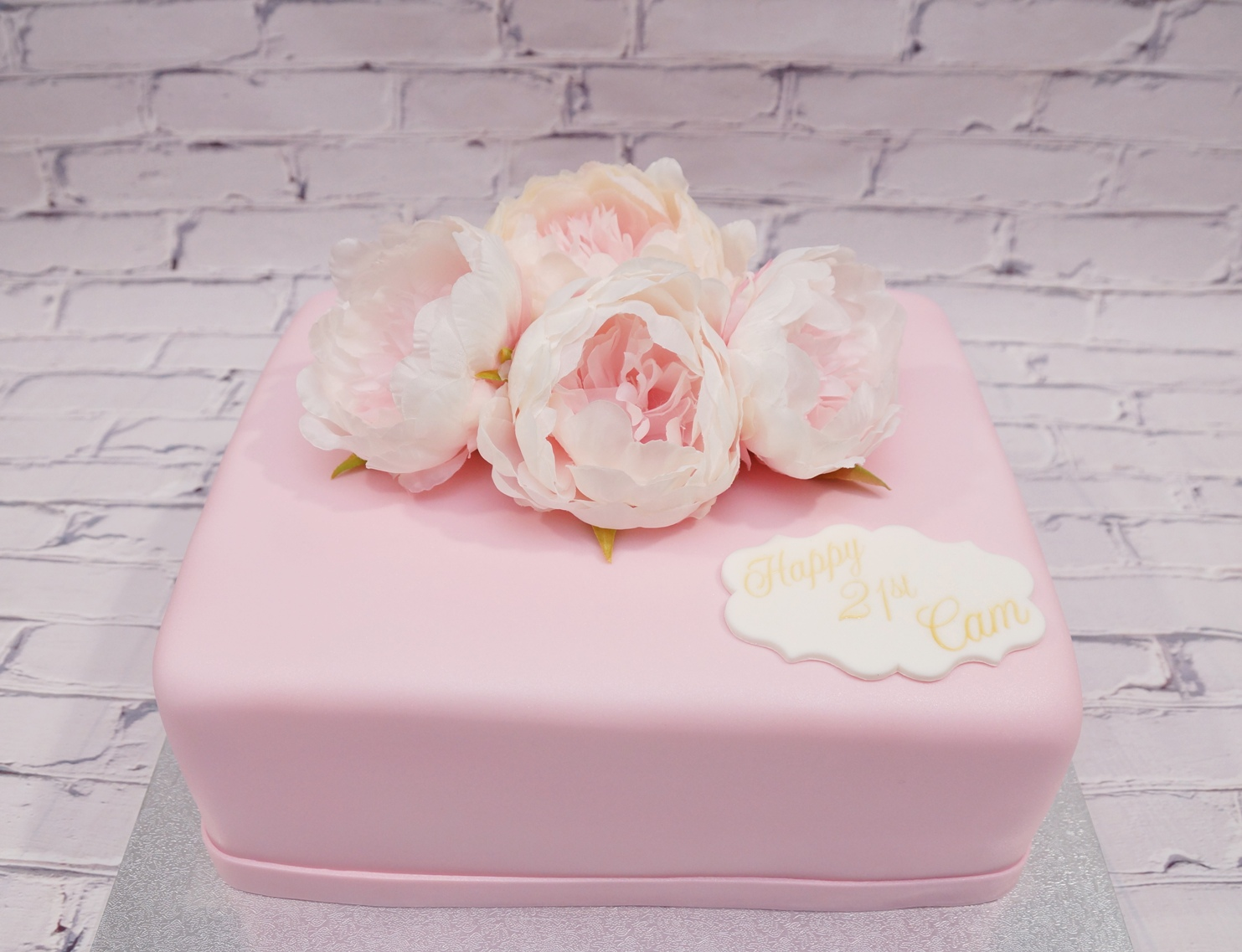 Pink rectangle cake with silk flowers 1.