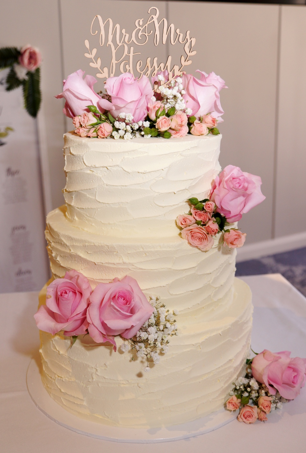 3 Tier rustic buttercream with fresh flo