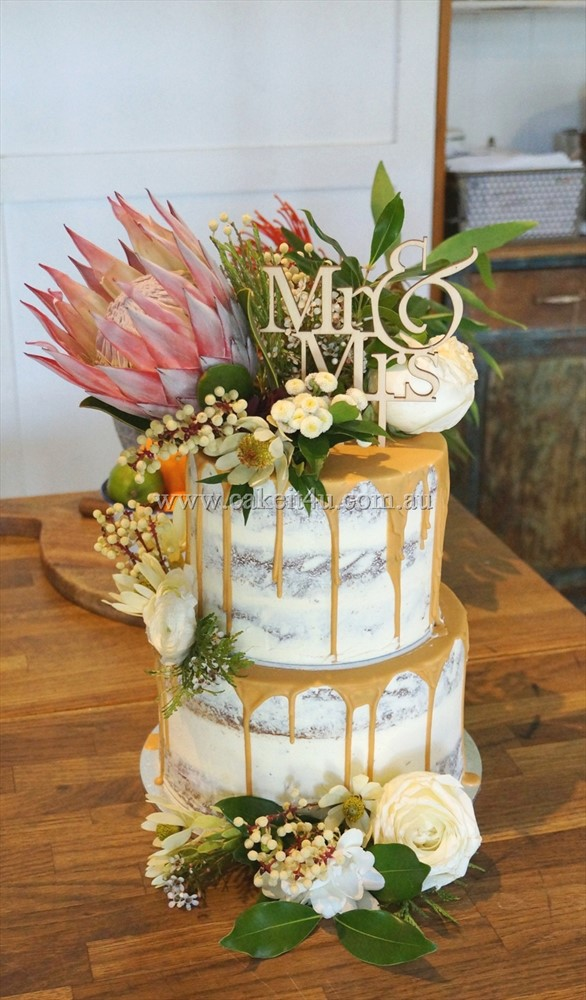 2 Tier semi Naked with caramel drip and native flowers 1
