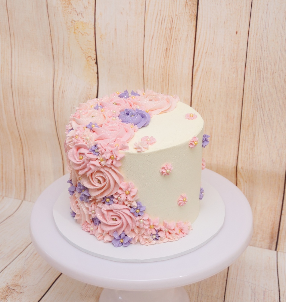 1 Tier white buttercream with pink & mau