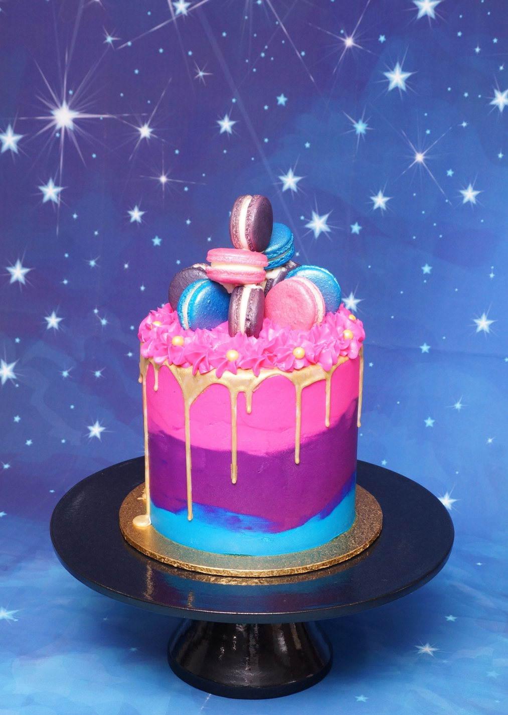 Bright pink, blue and purple buttercream