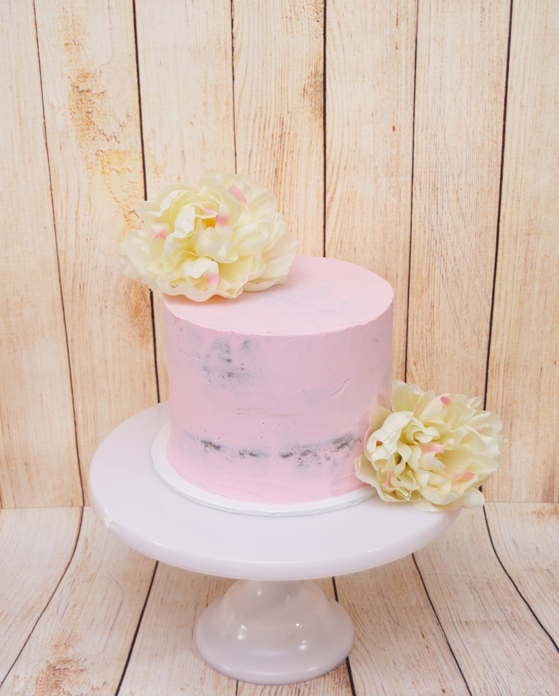 1 Tier Pink semi naked buttercream