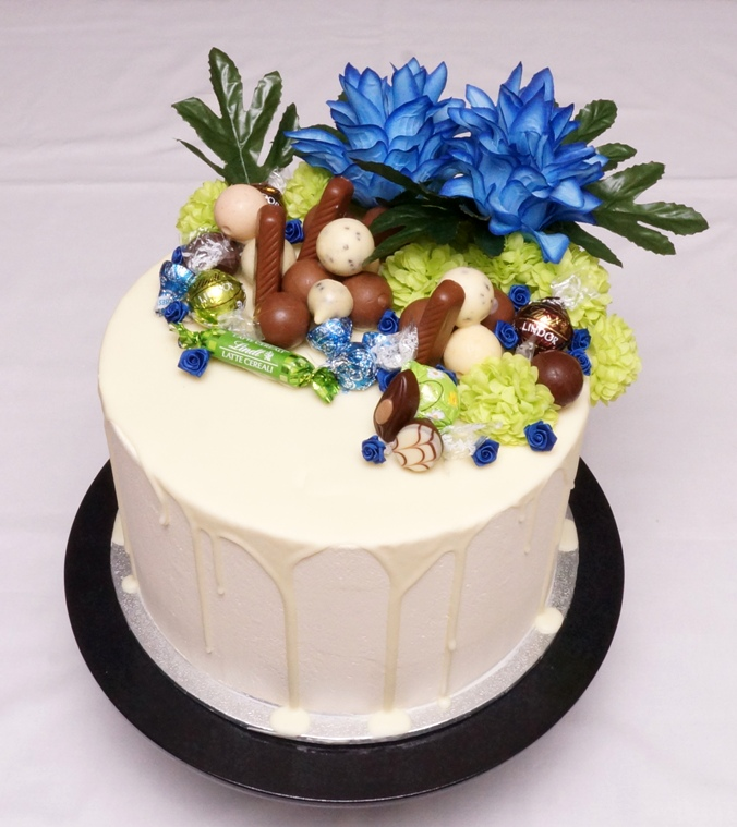 1 Tier Buttercream with chocolates and B