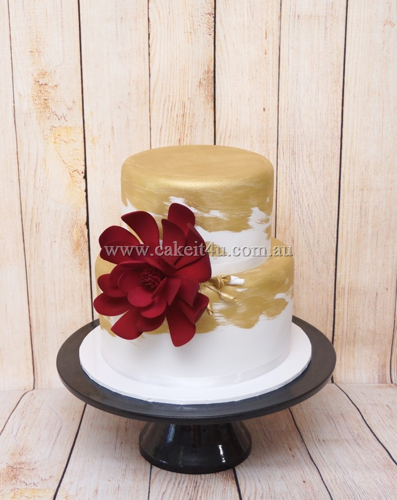 White fondant with gold paint and red flower