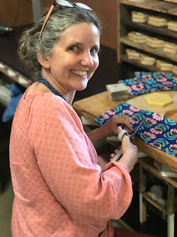 maker making beeswax wraps