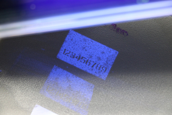 Fluorescent osmotic ink | security code label