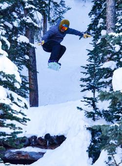 Snowboarder Air Threw The Tress