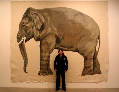 """Mayuka with her finished piece titled """"Billy"""""""