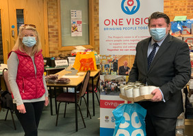 Dean Russell MP Watford visiting One Vision wearing a mask