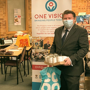 Dean Russell MP visiting One Vision wearing mask MP Watford