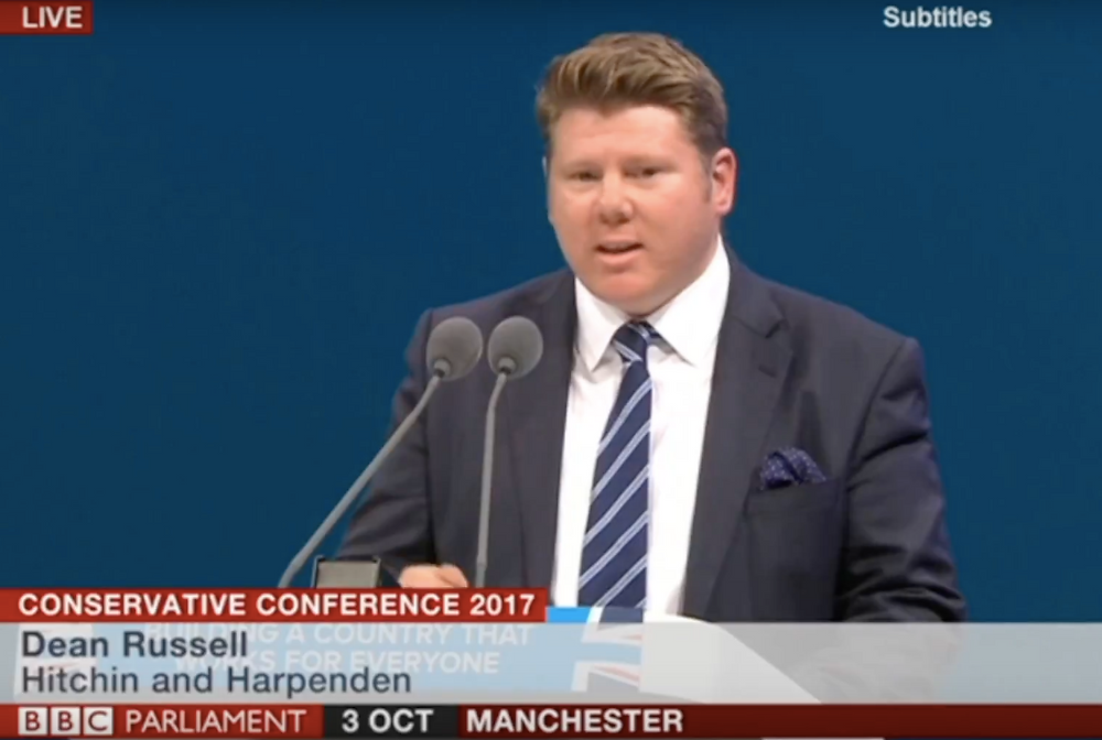 Dean Russell speaking at the Conservative Party Conference in Manchester