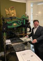 Dean Russell MP Watford using a printing press