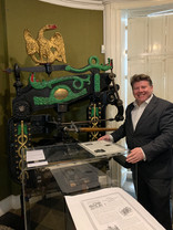 Dean Russell MP Watford using a printing press