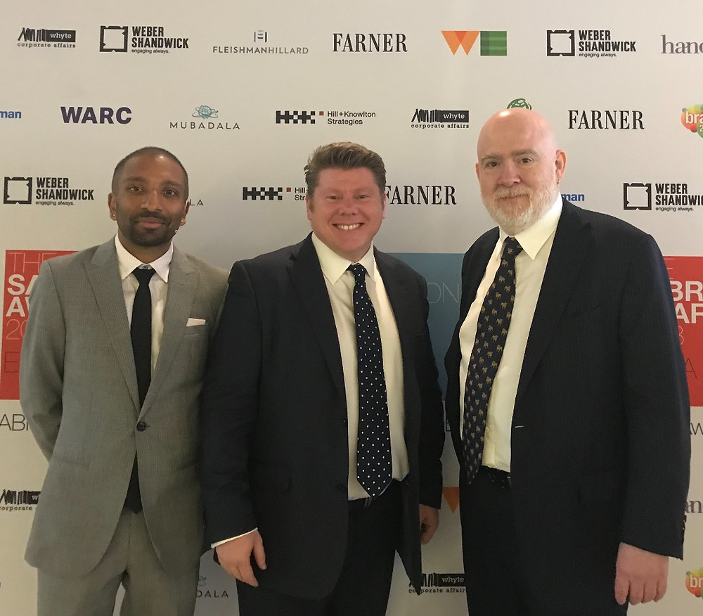 Epifny Consulting and Win That Pitch Founder Dean Russell with The Holmes Report's CEO Arun Sudhamen and Chairman Paul Holmes