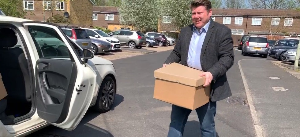 Dean Russell MP Watford packing boxes into a car
