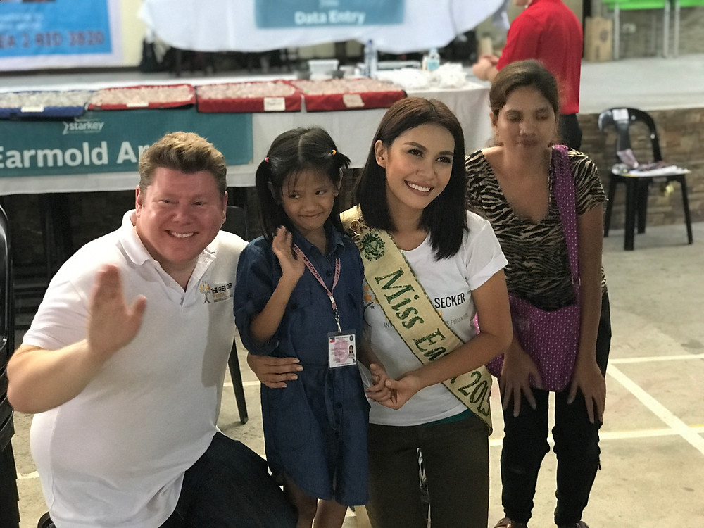 Dean Russell and Miss Earth Angelia Ong Following A Successful Hearing Aid Fitting