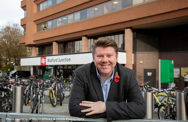 Dean Russell MP standing outside Watford Junction train station