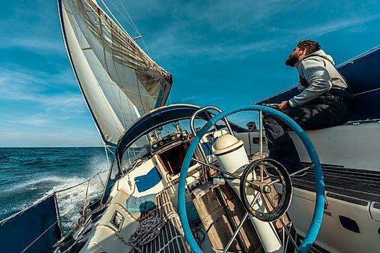 Luka Kosem sailing on his first boat