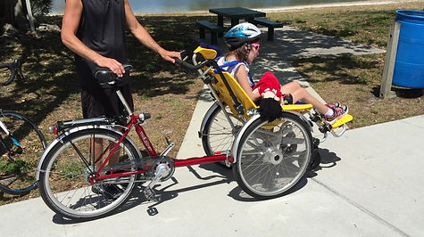 Duet Wheelchair Bicycle Tandem fun for children and adults.  Get outside and enjoy a bike ride with your loved ones.  The whole family will enjoy this adaptable bicycle.