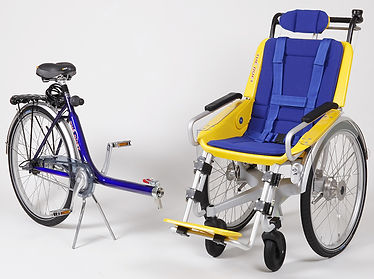 Duet Wheelchair Bicycle Tandem the wheelchair and bicycle disconnect from one another.  Making transportation a breeze!