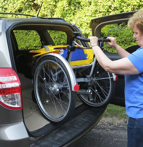 Duet Wheelchair Bicycle Tandem.  The wheelchair and the bicycle disconnect from one another to make transporting a breeze!  Take the Duet to the park or take it with you on vacation!  It's easy!!