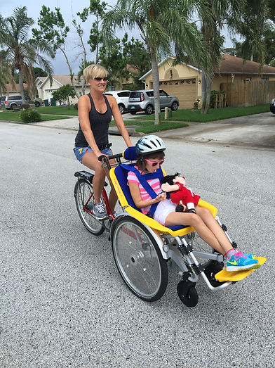 The Duet Wheelchair Bicycle Tandem from Mobility & Access getting outside and enjoying a ride in comfort and style.