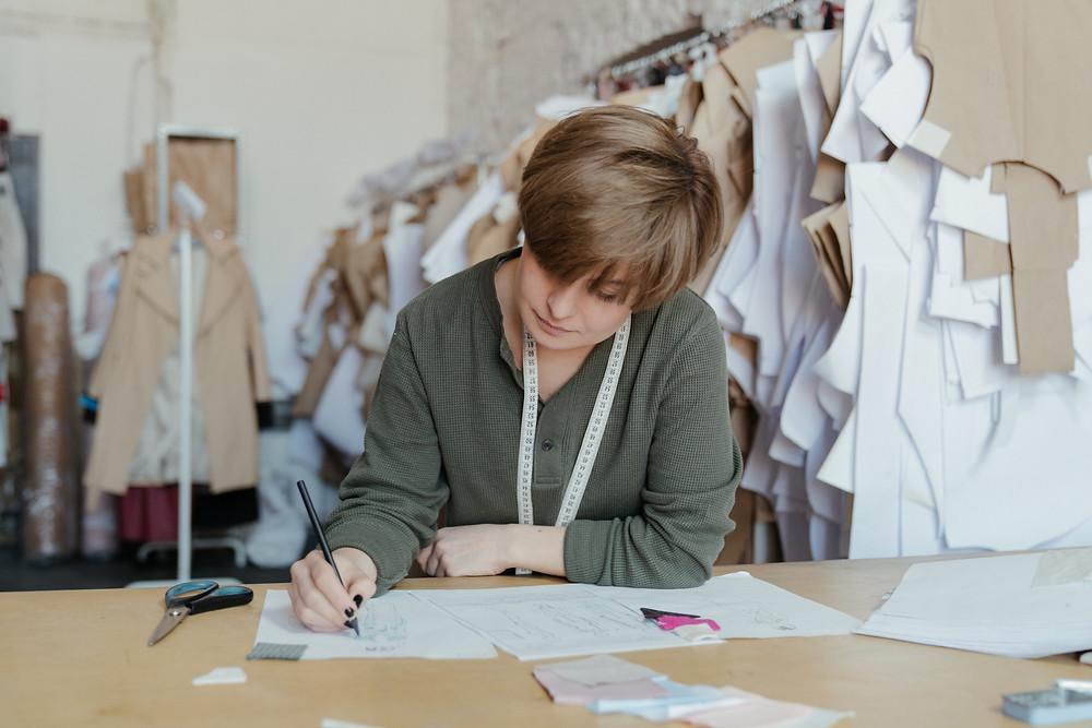Person sketching fashion drawing board Toronto
