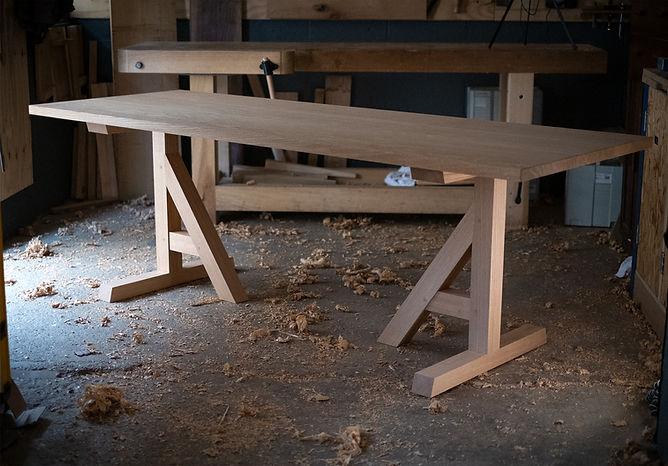 Clean oak trestle table.jpg