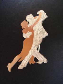Tango brooch