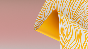 close up of yellow animal printed fabric against pastel background
