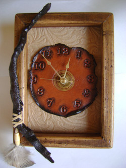 #176-Clock with stick & feathers