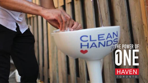 Volunteers Install Hand Washing Stations For Toronto's Homeless