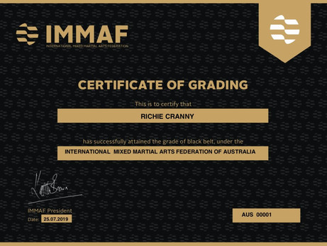 Coach Richie Cranny is presented with the first IMMAF Black Belt in Australia.